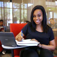 Student patron doing homework at a desk.