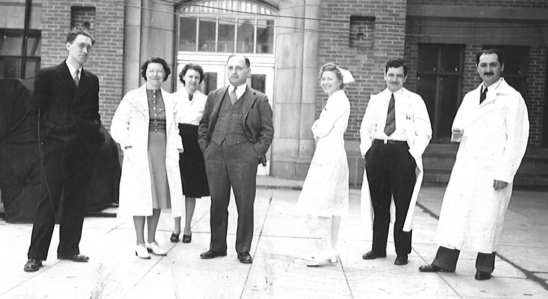 Dr. Abraham Low with colleagues, ca. 1940, Recovery International Collection