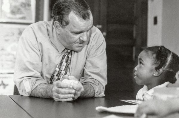 Richard M. Daley talking with a young girl.