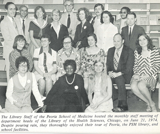 B/W photo from an undated Library of the Health Sciences newsletter depicting Beverly Allen with her colleagues from the Library of the Health Sciences in Chicago.